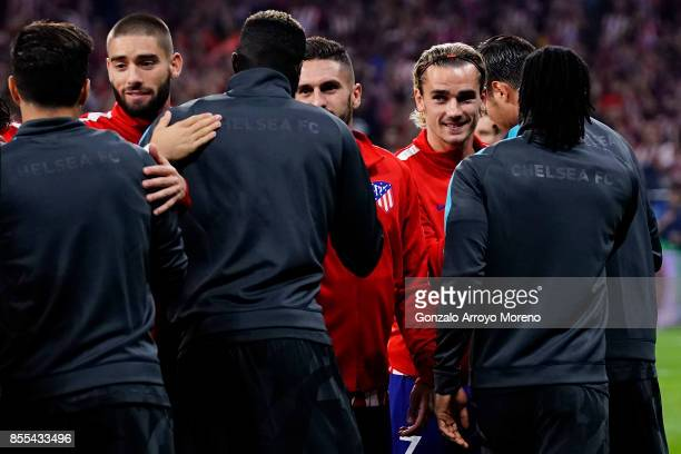 Atletico de Madrid players Antoine Griezmann Koke and Yannick Carrasco clashes hands with Chelsea FC players prior to start during the UEFA Champions...