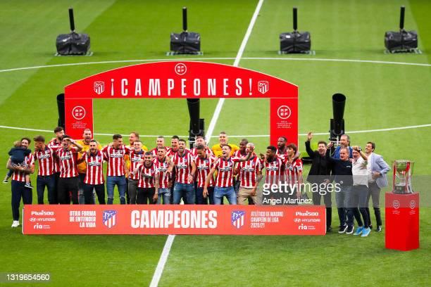 Atletico de Madrid players celebrate before receiving the La Liga trophy during the trophy presentation at Estadio Wanda Metropolitano on May 23,...