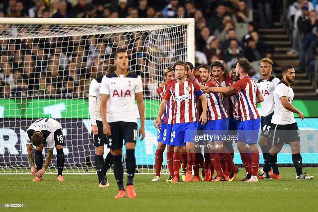 Atletico de Madrid players celebrate the goal of Diego Godin during 2016 International Champions Cup Australia match between Tottenham Hotspur and Atletico de Madrid at Melbourne Cricket Ground on July 29, 2016 in Melbourne, Australia.