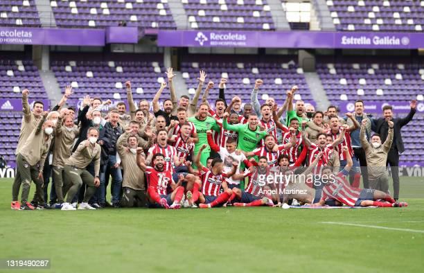 Atletico de Madrid players celebrate winning the La Liga Santander title after victory in the La Liga Santander match between Real Valladolid CF and...