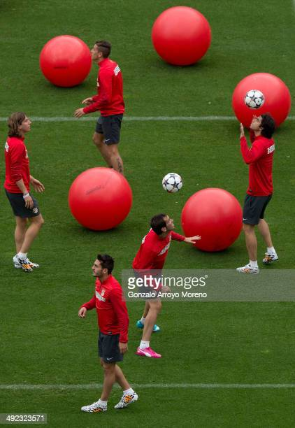 Atletico de Madrid players Diego Godin Tiago Mendes Koke and Filipe Luis exercise during the training session held on the Media Day prior to UEFA...
