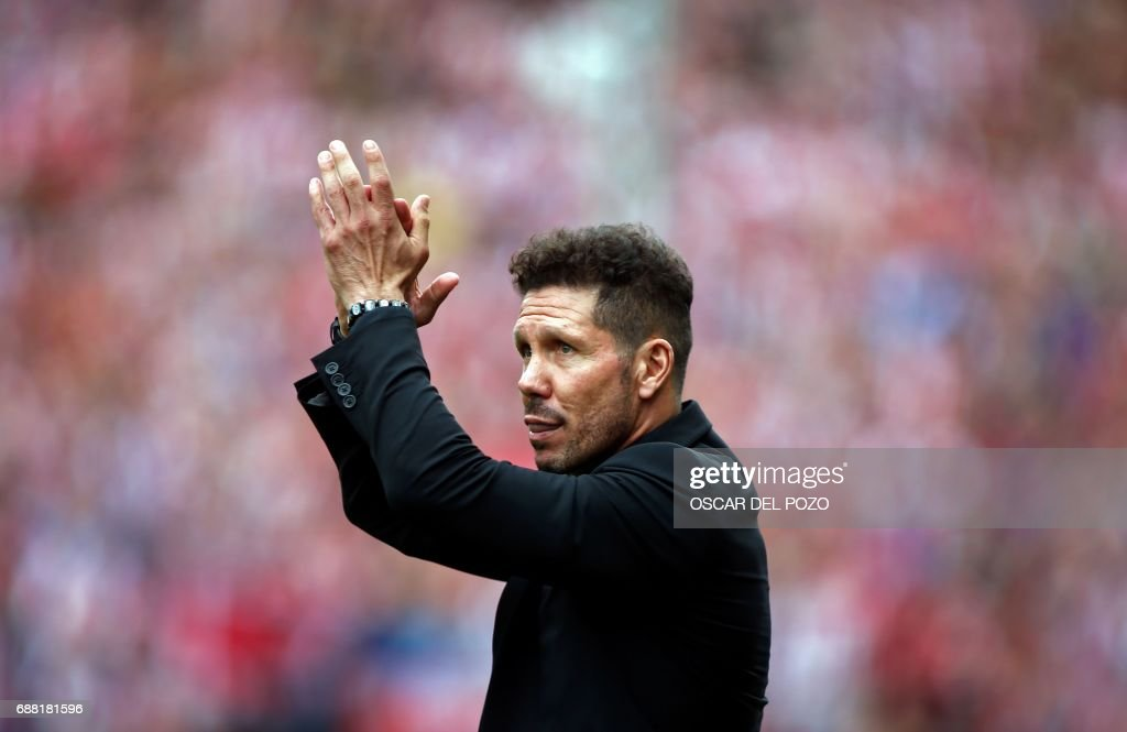 Atletico de Madrid's Argentinian coach Diego Pablo Simeone claps during a celebration bidding farewell to the team's stadium after the Spanish league football match Club Atletico de Madrid vs Athletic Club Bilbao at the Vicente Calderon stadium in Madrid on May 21, 2017. Atletico Madrid's mythical Vicente Calderon stadium will soon be history: sad news for supporters of Real Madrid's rivals but not so for locals who hope the neighbourhood will improve once noisy fans are gone. This weekend spells the end for the ageing structure that for over 50 years has housed Atletico Madrid -- not as well known abroad as the world-famous Real Madrid despite fielding players like French star Antoine Griezmann but with a huge following in the Spanish capital. POZO