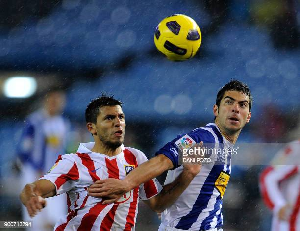 Atletico de Madrid's Argentinian forward Kun Aguero vies with Espanyol's midfielder Julian Amat during the Spanish King's Cup football match Atletico...