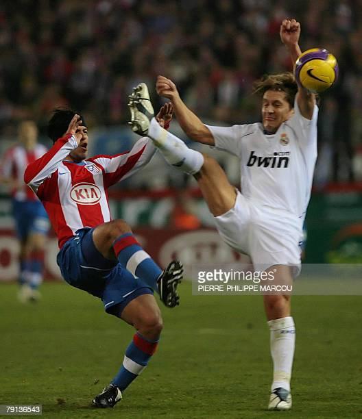 Atletico de Madrid's Argentinian forward Kun Aguerro vies with Real Madrid's Spanish defender Michel Salgado during a Spanish league football match...