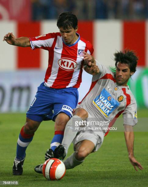 Atletico de Madrid's Argentinian forward Sergio Leonel Aguerro is tackled by Mallorca's Spanish defender H?ctor during their Liga football match at...