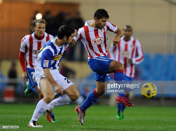 Atletico de Madrid's Argentinian forward vies with Espanyol's midfielder Julian Amat during the Spanish King's Cup football match Atletico Madrid vs...