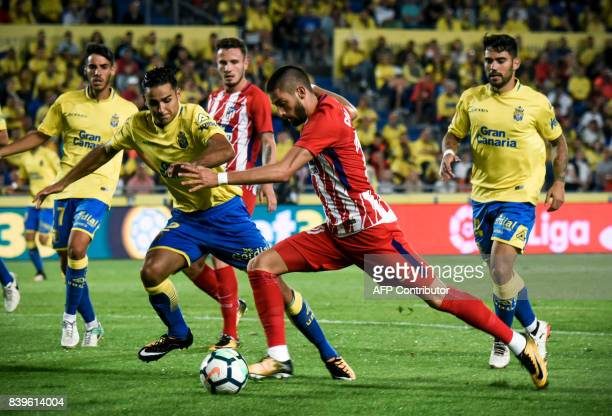 Atletico de Madrid's Belgian midfielder Yannick Ferreira Carrasco vies with Las Palmas' defender David Simon during the Spanish league football match...