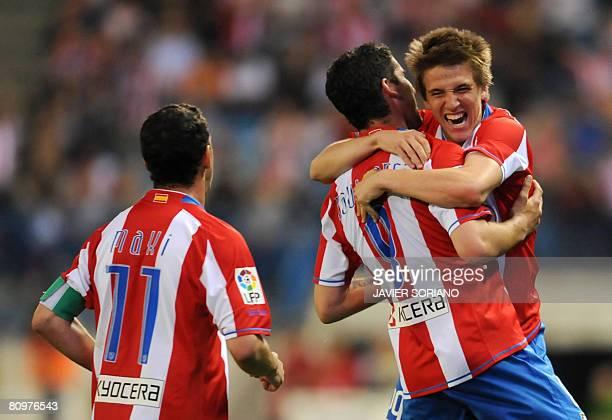 Atletico de Madrid's Camacho celebrates with teammate Raul Garc?a after scoring their third goal against Recreativo de Huelva during a Spanish league...