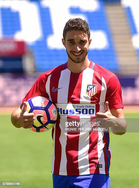 Atletico de Madrid's Croatian defender Sime Vrsaljko gives the thumbs up as he poses on the pitch during his presentation as new player of the club...