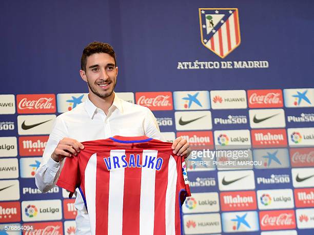 Atletico de Madrid's Croatian defender Sime Vrsaljko poses with his new jersey during his presentation as new player of the club at the Vicente...