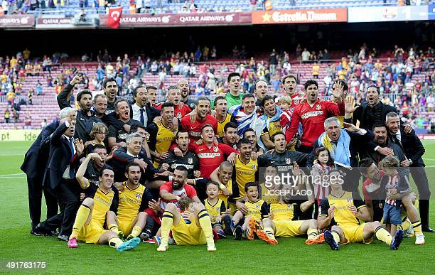 Atletico de Madrid's football players and staff pose as they celebrate their Spanish league title at the end of the Spanish league football match FC...