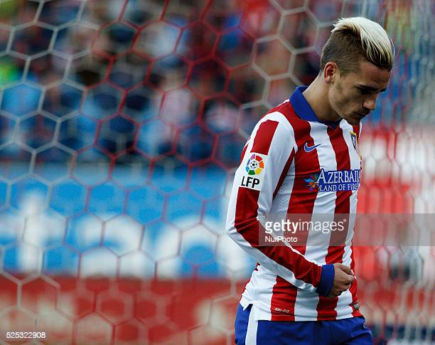 Atletico de Madrid's French forward Antoine Griezmann Celebrates a goal during the Spanish League 2014/15 match between Atletico de Madrid and Real...