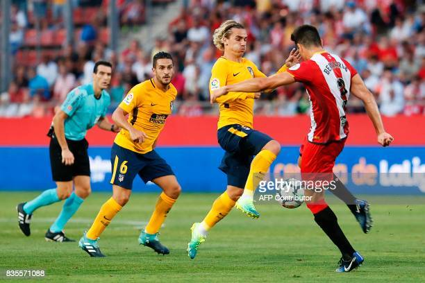 Atletico de Madrid's French forward Antoine Griezmann vies with Girona's Colombian Bernando Espinosa during the Spanish league footbal match Girona...