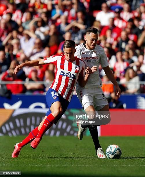 Atletico de Madrid's Marcos LLorente and Sevilla FC's Lucas Ocampos are seen in action during the Spanish La Liga match round 27 between Atletico de...