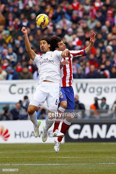 Atletico de Madrid's Portuguese midfielder Tiago Cardoso and Real Madrid's German midfielder sami khedira during the Spanish League 2014/15 match...