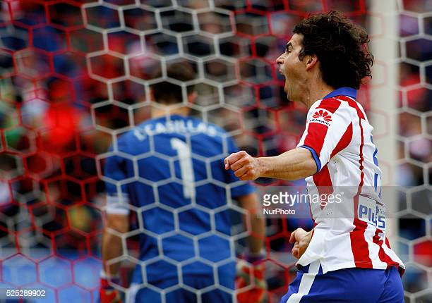 Atletico de Madrid's Portuguese midfielder Tiago Cardoso celebrates a goal during the Spanish League 2014/15 match between Atletico de Madrid and...