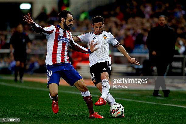 Atletico de Madrid's Spanish Defender Juanfran Torres and Valencia's Argentinean forward Pablo Piatti during the Spanish League 2014/15 match between...