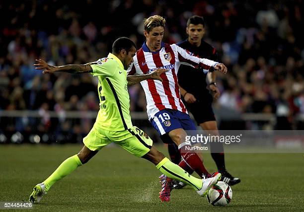 Atletico de Madrid's Spanish forward Fernando Torres and FC Barcelona's Brazilian defender Daniel Alves during the Spanish Kings cup 2014/15 match...