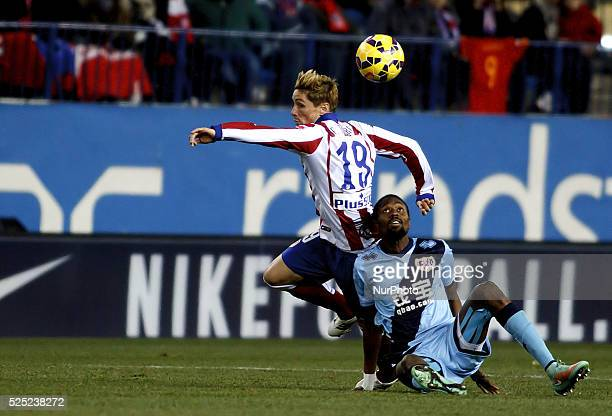 Atletico de Madrid's Spanish forward Fernando Torres and Rayo Vallecanos Ghanaian midfielder player MOHAMMED FATAU during the Spanish League 2014/15...