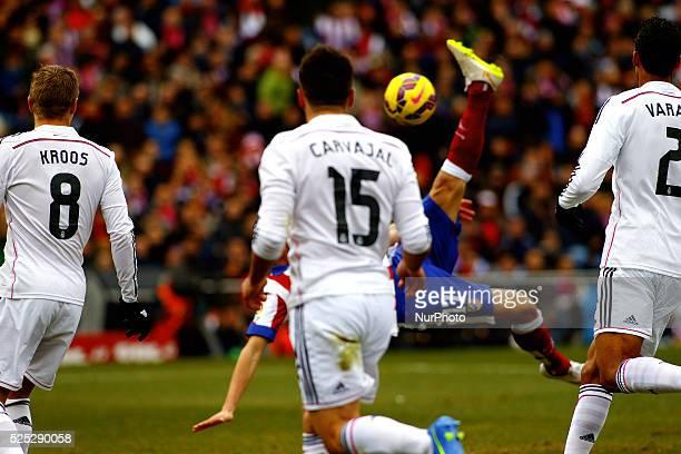 Atletico de Madrid's Spanish midfielder Saul ��iguez scores a goal during the Spanish League 2014/15 match between Atletico de Madrid and Real Madrid...