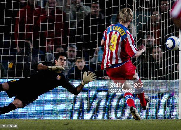 Atletico de Madrid's Torres scores a penalty over Barcelona's Victor Valdes during a Spanish League soccer match in Barcelona 06 February 2005...
