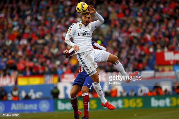Atletico de Madrid's Uruguayan Defender Diego Godin and Real Madrid's French forward Karim Benzema during the Spanish League 2014/15 match between...