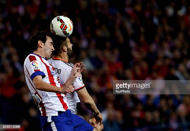 Atletico de Madrid's Uruguayan Defender Diego Godin and Valencia's Spanish forward Alvaro Negredo during the Spanish League 2014/15 match between...