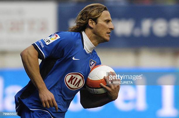 Atletico de Madrid's Uruguayan Diego Forlan celebrates after scoring against Osasuana during a Spanish league football match on February 24 2008 at...