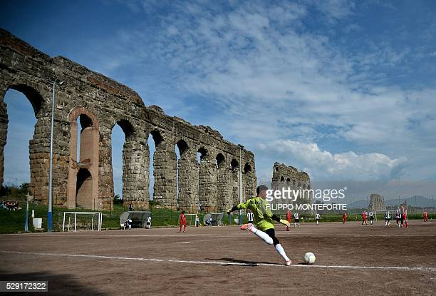 TOPSHOT Atletico Diritti's and Cetus Roma's players compete during a local third category football match between Atletico Diritti and Cetus Roma on...