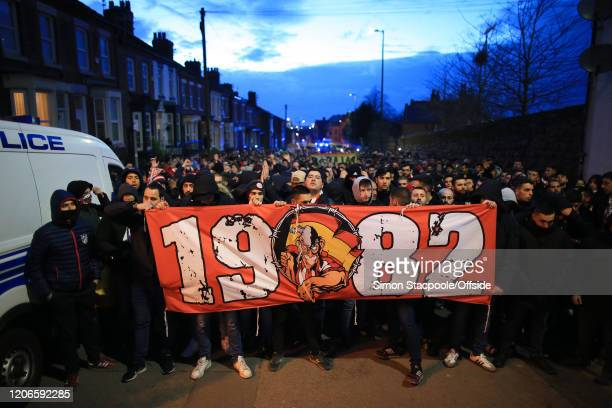 Atletico fans make their way to the UEFA Champions League round of 16 second leg match between Liverpool FC and Atletico Madrid at Anfield on March...