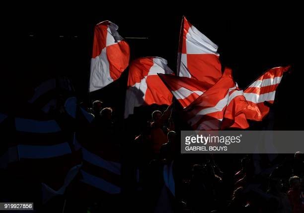 Atletico fans wave flags during the Spanish league football match between Club Atletico de Madrid vs Athletic Club Bilbao at the Wanda Metropolitano...