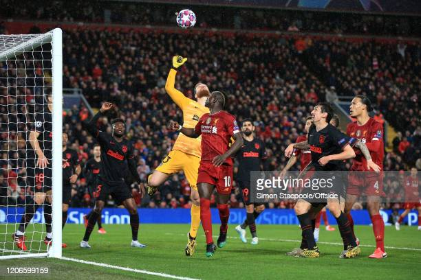 Atletico goalkeeper Jan Oblak punches the ball clear during the UEFA Champions League round of 16 second leg match between Liverpool FC and Atletico...