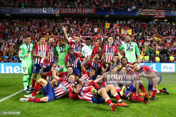 Atletico Madrid celebrate victory with the trophy following the UEFA Super Cup between Real Madrid and Atletico Madrid at Lillekula Stadium on August...