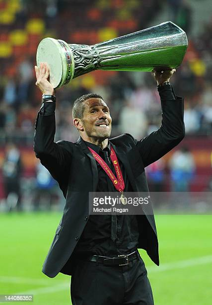 Atletico Madrid Coach Diego Simeone holds the trophy aloft at the end of the UEFA Europa League Final between Atletico Madrid and Athletic Bilbao at...