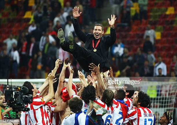 Atletico Madrid Coach Diego Simeone is thrown in the air by his players following their victory at the end of the UEFA Europa League Final between...