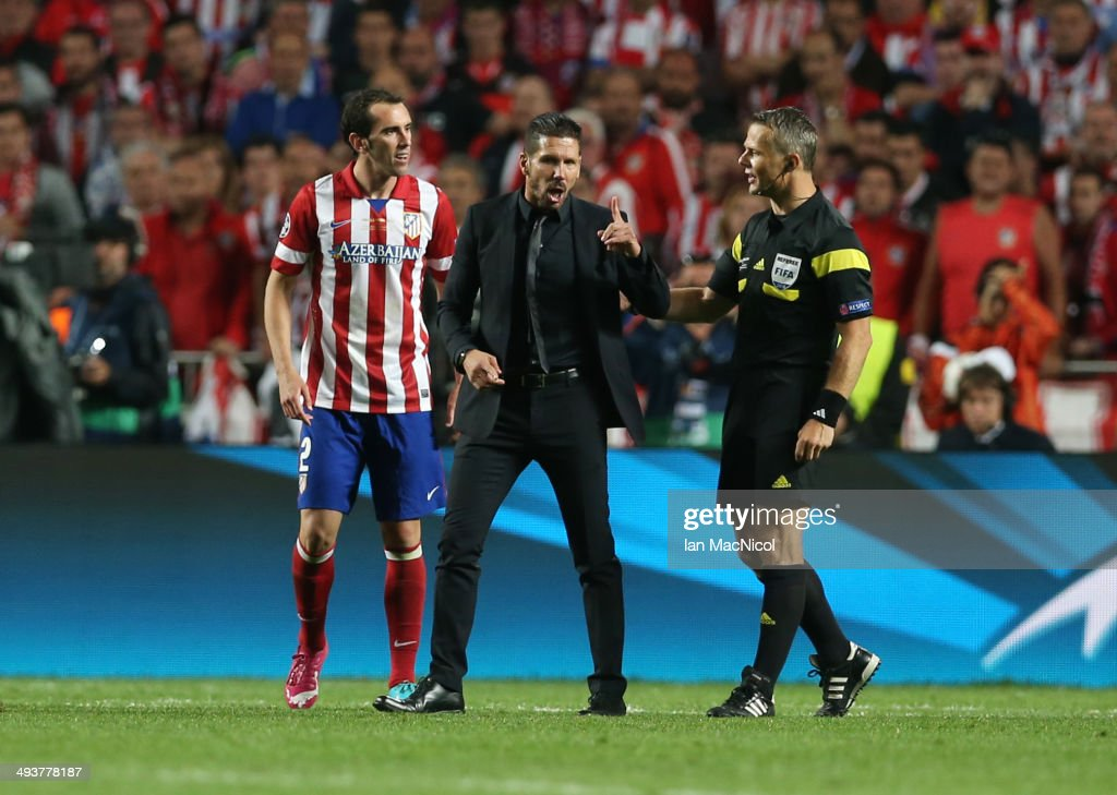 Atletico Madrid coach Diego Simeone remonstrates with referee Bjorn Kuipers during the UEFA Champions League Final match between Real Madrid and Athletico Madrid at The Estadio da Luz on May 24, 2014 in Lisbon, Portugal.