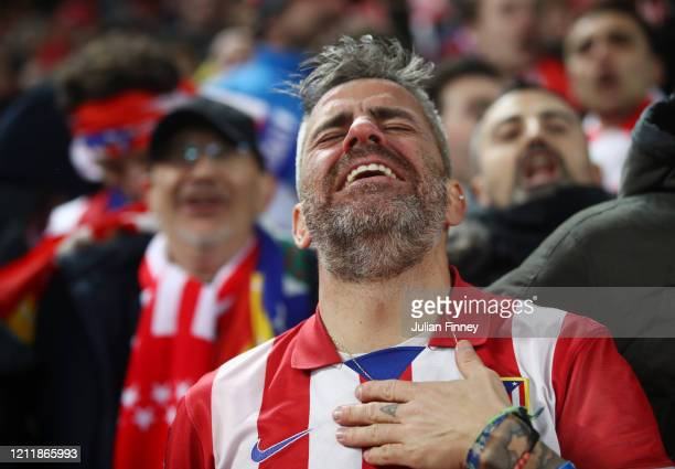 Atletico Madrid fan celebrates his sides third goal during the UEFA Champions League round of 16 second leg match between Liverpool FC and Atletico...
