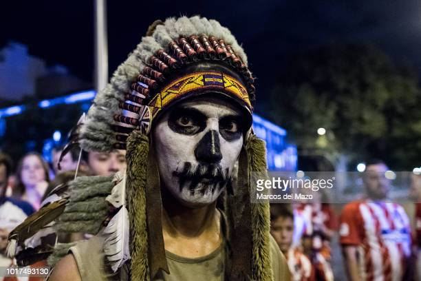 Atletico Madrid fan dressed as an Indian celebrating at Neptuno Square after the team won the UEFA Super Cup in a match against Real Madrid by 42 in...