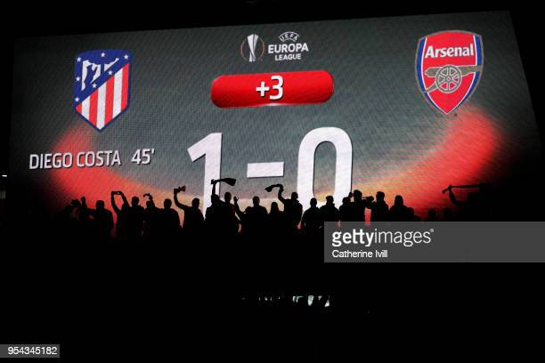 Atletico Madrid fans celebrate after winning the UEFA Europa League Semi Final second leg match between Atletico Madrid and Arsenal FC at Estadio...