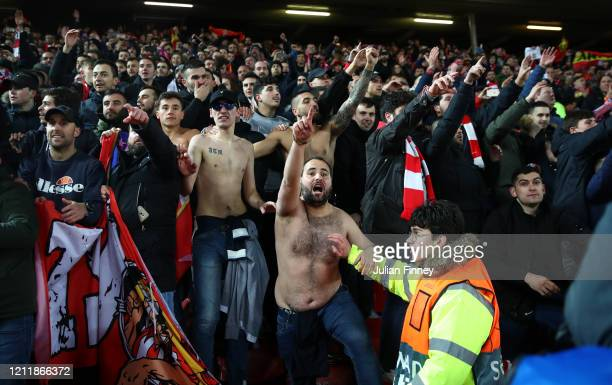 Atletico Madrid fans celebrate victory after the UEFA Champions League round of 16 second leg match between Liverpool FC and Atletico Madrid at...