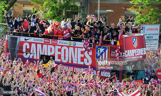 Atletico Madrid fans welcome their team at Plaza Neptuno during celebrations a day after winning the Europa League Final on May 10 2012 in Madrid...