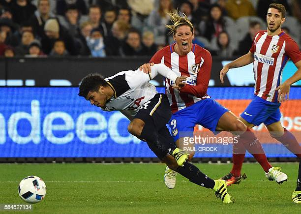 Atletico Madrid forward Fernando Torres and Tottenham Hotspur's DeAndre Yedlin fight for the ball during the International Champions Cup football...