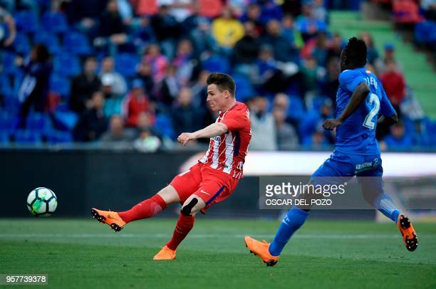 Atletico Madrid French's forward Gameiro vies with Getafe's defender Djene during the Spanish league football match between Getafe and Atletico...