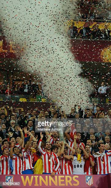 Atletico Madrid lift The UEFA Europa League Trophy after defeating Athletic Bilbao 30 in the UEFA Europa League Final 2012