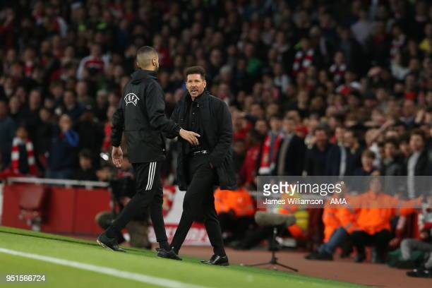 Atletico Madrid manager Diego Simeone protests to Fourth Official Hicham Zakrani after being sent from the technical area by match referee Clement...