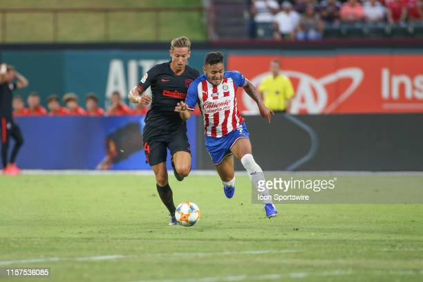 Atletico Madrid midfielder Marcos Llorente and Guadalajara midfielder Alexis Vega fight for the ball during the International Champions Cup between...