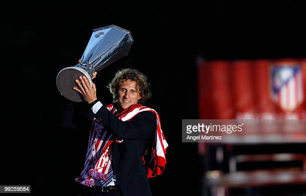 Atletico Madrid player Diego Forlan celebrates with the trophy at the Neptuno fountain in Madrid the day after Atletico won the UEFA Europa League...