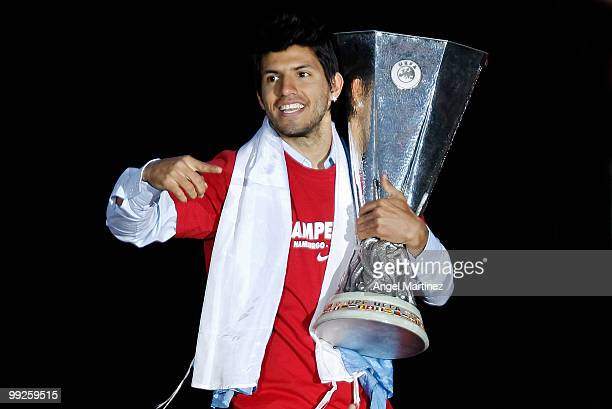 Atletico Madrid player Sergio Aguero celebrates with the trophy at the Neptuno fountain in Madrid the day after Atletico won the UEFA Europa League...