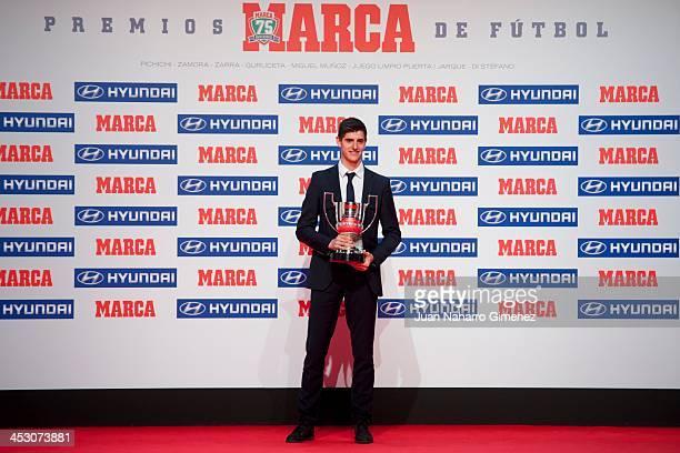 Atletico Madrid player Thibaut Courtois receives the 'Zamora de Primera Award' during Premios MARCA de Futbol Gala on December 2 2013 in Madrid Spain