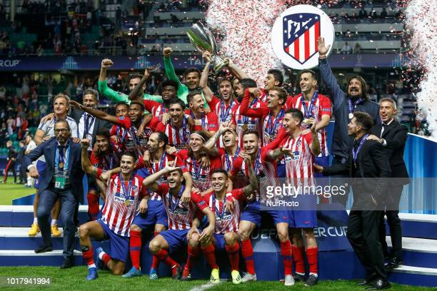 Atletico Madrid players and staff celebrate with the trophy after the UEFA Super Cup match between Real Madrid and Atletico Madrid on August 15, 2018...